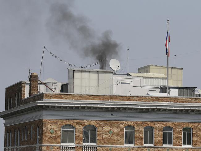 Black smoke rises from the roof of the Consulate-General of Russia after the US ordered it to close the consulate and others in New York and San Francisco within 48 hours. Picture: AP Photo/Eric Risberg.