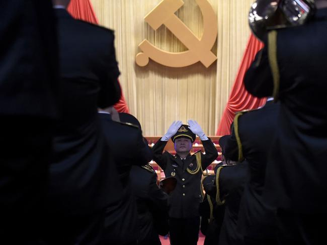 A Chinese People's Liberation Army (PLA) officer practices conducting a military band before the opening session of the Chinese Communist Party's five-yearly Congress. Picture: Wang Zhao/AFP