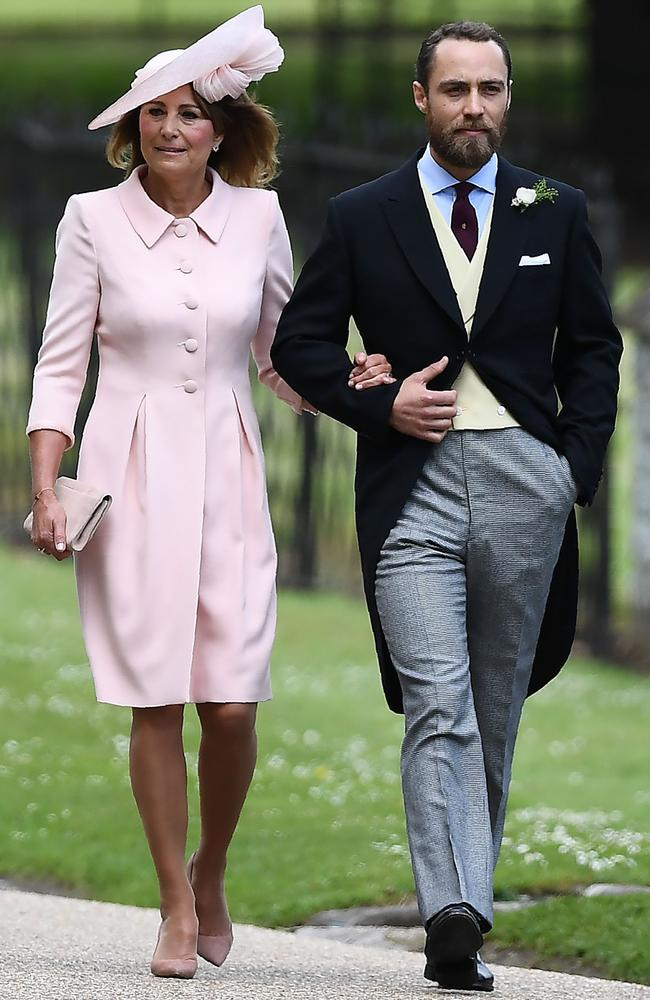 James Middleton walks with his mother Carole Middleton into the grounds.