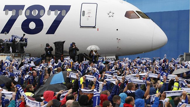 Boeing employees hold their scarfs up as All Nippon Airways received their first 787 Dreamliner. Picture: AFP