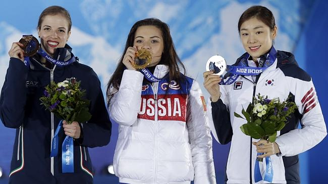 (l-r) Italy's Carolina Kostner (bronze) Russia's Adelina Sotnikova (gold) and South Korea's Kim Yu-Na (silver) pose with their medals.