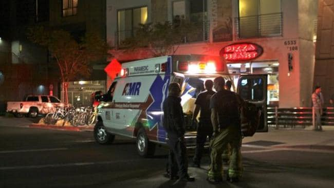 Murder ... paramedics at the scene of the rampage next to the University of California. Picture: NOOZHAWK
