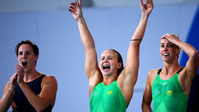 Bronte Campbell (L), Melanie Schlanger (C) and Emma McKeon of Australia cheer on the way to setting the record.