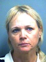 In this handout image provided by Palm Beach County Sheriff Department (PBSO), Alla Vadimirovna Kournikova, 46, mother of tennis player Anna Kournikova poses for a mug shot booking photo in Palm Beach, Florida. Kournikova was arrested on January 19, 2010 and is accused of allegedly leaving her son alone for almost an hour while she went to the bank and the post office. She told police the boy did not want to go along with her and was left with a phone while watching television.