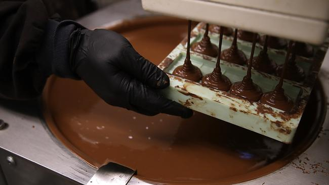 A worker at Kiva Confections in Oakland makes marijuana infused chocolate bars on January 16. Less than one month after recreational marijuana sales became legal in California, dispensaries are reporting a shortage in pot edibles. Picture: Justin Sullivan/Getty Images/AFP