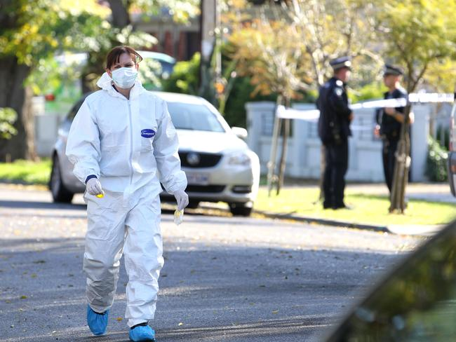 Police investigate the murder in Alberton yesterday. Picture Stephen Laffer