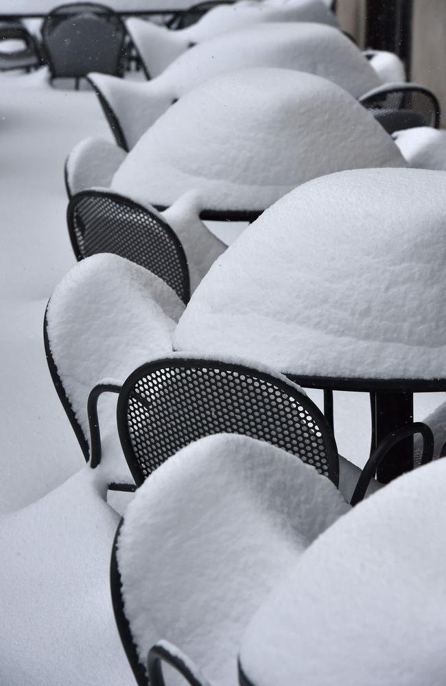 Nature's canvass ... A snow covered restaurant terrace is seen in Washington, DC. Source: AFP