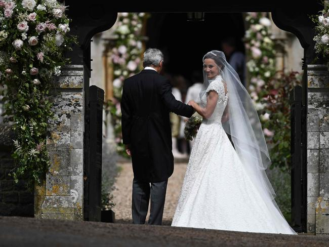 Pippa Middleton is escorted by her father Michael Middleton, as she arrives for her wedding to James Matthews.