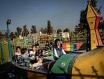 MOSUL, IRAQ - NOVEMBER 04: Children enjoy a train ride at the Mosul Amusement Park on November 4, 2017 in Mosul, Iraq. The theme park was shut down under ISIS occupation and the grounds were riddled with mines and IED's, after the liberation staff returned to rebuild the park and rides and reopened on the 5th of October. Picture: Chris McGrath/Getty Images)=