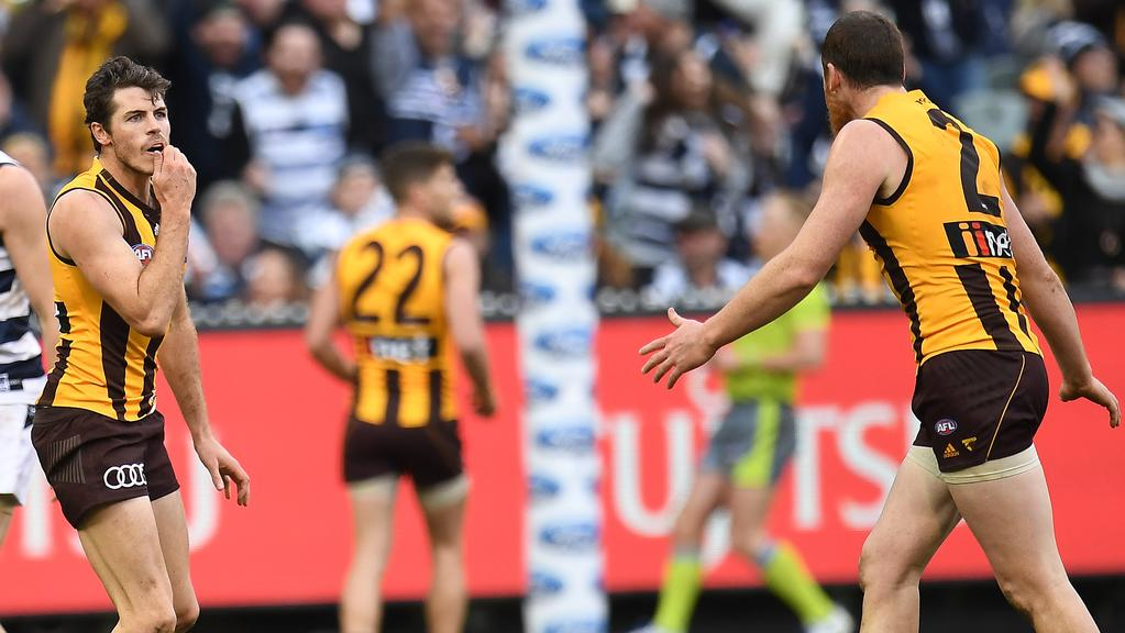 Isaac Smith of the Hawks reacts after missing a shot on goal in the dying seconds of the game against Geelong. (AAP Image/Julian Smith)