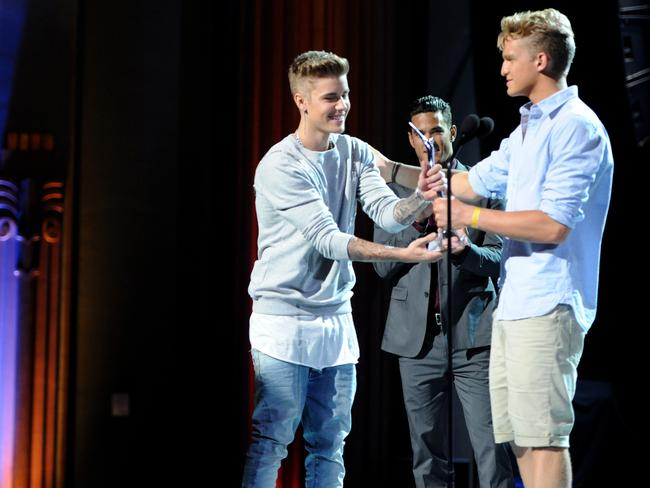 Simpson presents his pal Justin Bieber with a charity award at the Young Hollywood Awards.