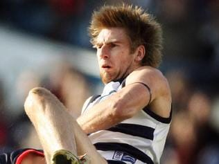 26/08/2006 SPORT: Geelong v Melbourne. Skilled Stadium. Tom Lonergan (top) is hurt during a crunching tackle.
