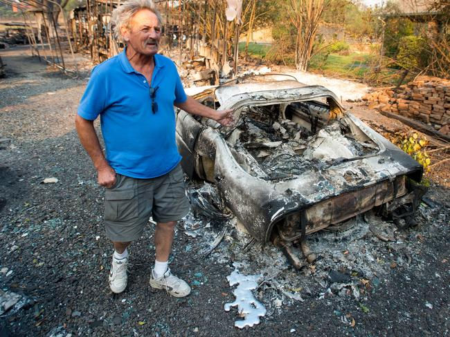 Resident Louis Reavis views his burned classic Corvette at his home in Napa. Picture: AFP