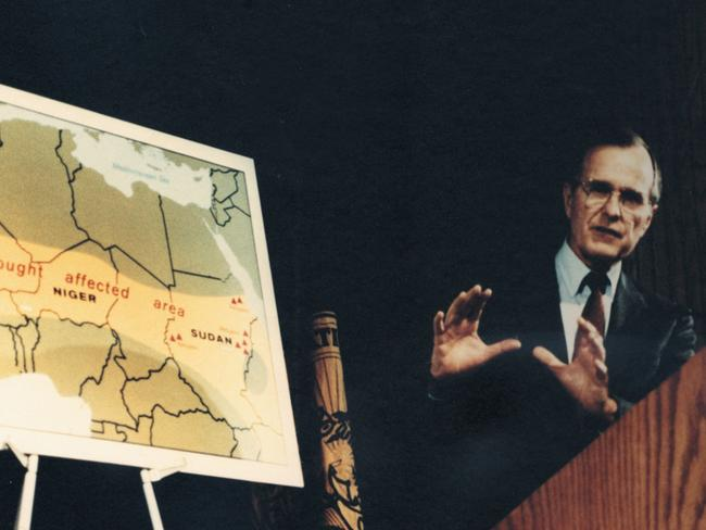 President George H.W. Bush stands in front of a CIA map of drought hit Africa in 1985. Picture: CIA