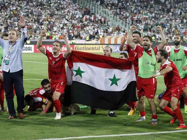 Syria's players celebrate.