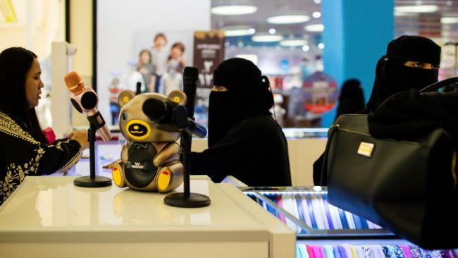 Saudi women sell products from a stall at the Al Yasmin mall in Jeddah, Saudi Arabia. Photo: Bloomberg via Getty