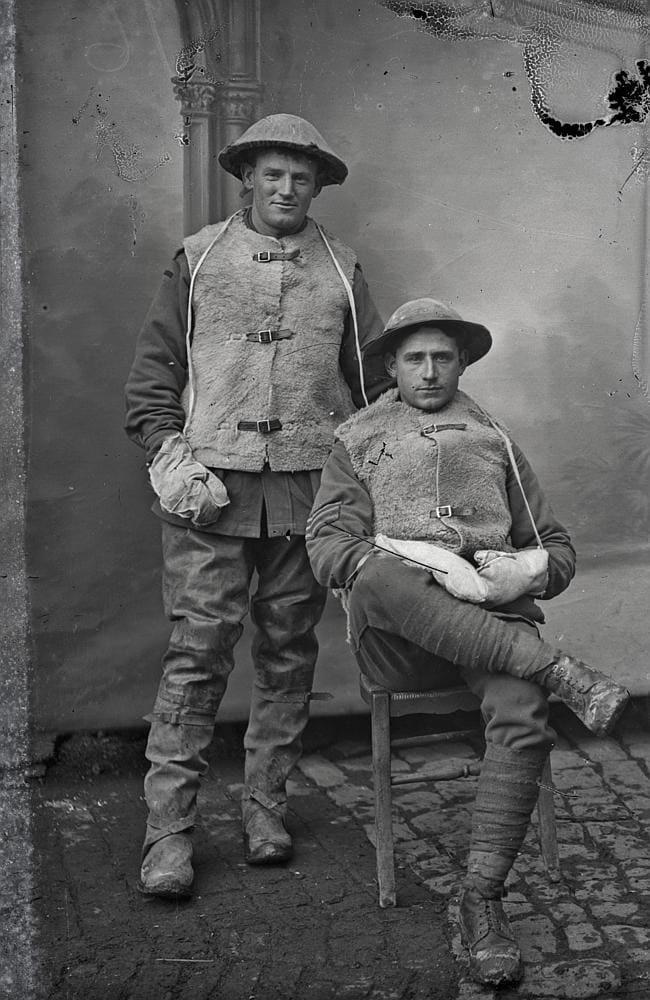 Portrait of two unidentified Australian soldiers of the 1st Division wearing sheepskin vests and mittens to ward off the cold...