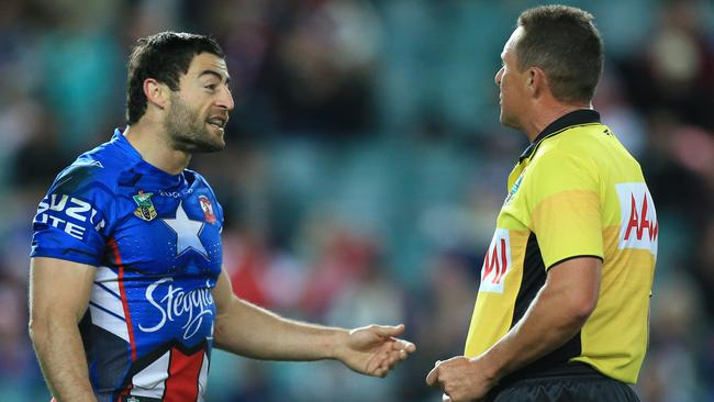 Anthony Minichiello argues with referee Shayne Hayne over a quick tap from which the Dragons scored.