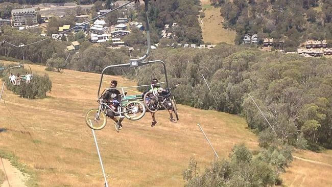 Mountain bikers getting a lift to the top of the mountain in style.