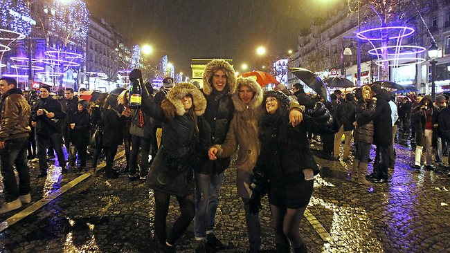 Revelers celebrate the New Year on the Champs Elysee in Paris. (AP Photo/Remy de la Mauviniere)