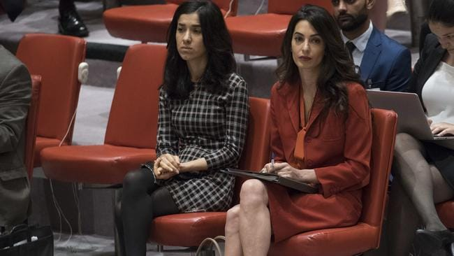 Human rights lawyer Amal Clooney, right, and her client Nadia Murad attend a Security Council meeting at United Nations headquarters. Picture: AP.