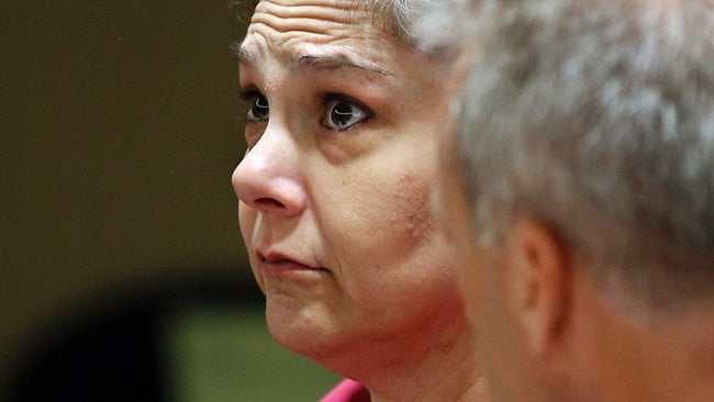 Elisa Baker's listens as her lawyer Scott Reilly explains court proceedings. Baker will serve 14 years and seven months to 18 years in prison for killing her stepdaughter. Picture: AP