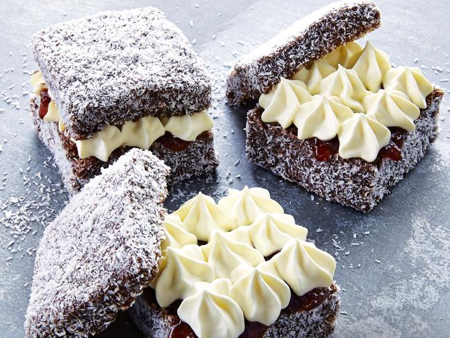 Delicious ... Jam and vanilla cream lamingtons. Picture: Al Richardson