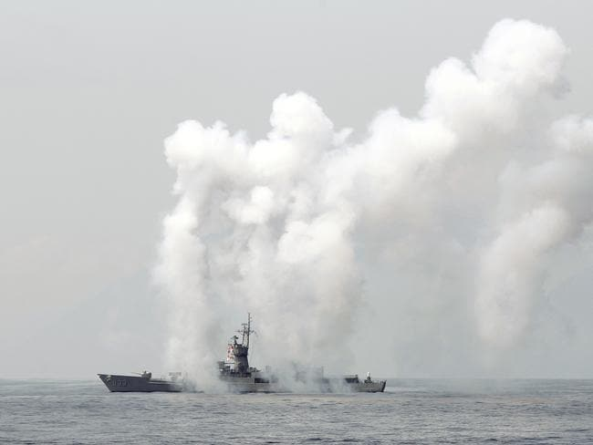 Taiwan's Knox-class frigate fires chaff during a navy exercise in the northeast of Taiwan last Friday. Picture: Chiang Ying-ying/AFP