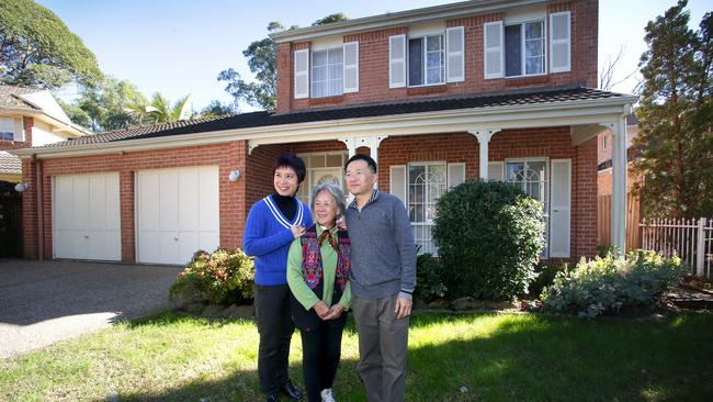 Mark Huang and his wife Melissa Juang with Mei Fang Lu outside their home at16 Danbury Close, Marsfield which will be auctioned this weekend.