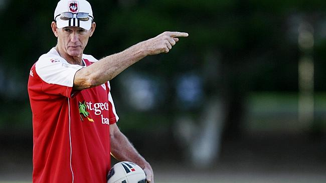 Former Dragons coach Wayne Bennett instructs his players during a St George-Illawarra team pre-season training at Wollongong.