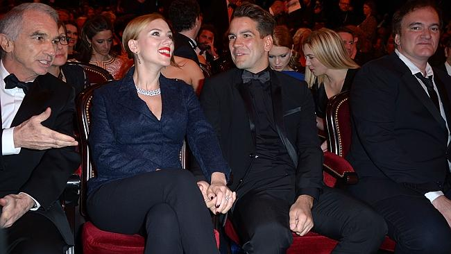 Scarlett Johansson, Romain Dauriac and director Quentin Tarantino sit in the audience before the start of the 39th Cesar Film Awards 2014 at Theatre du Chatelet on February 28, 2014 in Paris, France. (Photo by Dominique Charriau/Getty Images)
