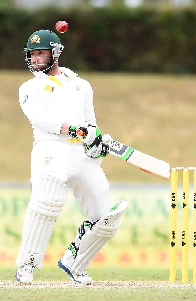 Phil Hughes ducks away from a bouncer during the match between Australia A and South Africa A.