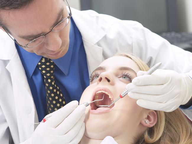 Easier to pull out your own rotten teeth ... Many rural people have to drive for over and hour and a half to reach a dentist. Picture: News Corp Australia