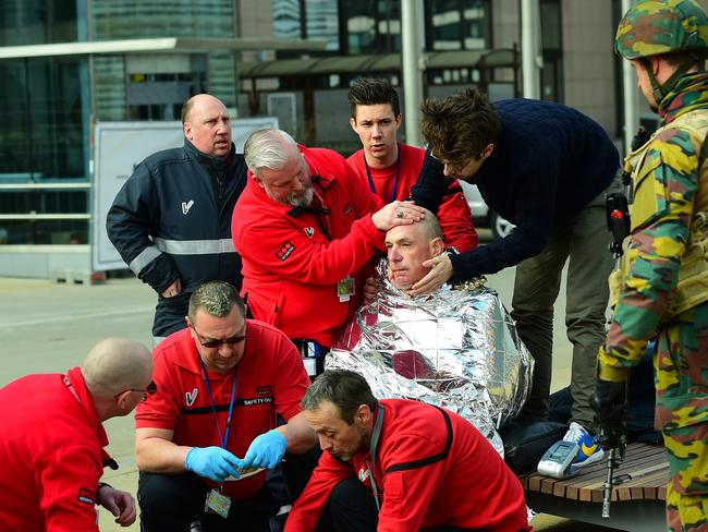 A victim receives first aid near Maelbeek metro station. Picture: AFP / EMMANUEL DUNAND