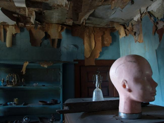 """The Doll House Mansion (Philadelphia, PA) is an abandoned mansion full of nothing but dolls and organised metal saws and tools neatly displayed on metal shelves through out several rooms."""