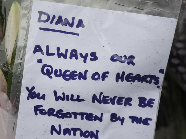 A tribute to the late Princess Diana is attatched on the gates outside of Kensington Palace, in London. Picture: AP