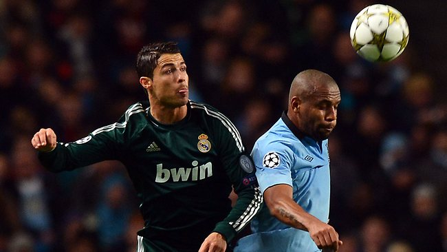 Real Madrid's Cristiano Ronaldo, left, jumps with Manchester City's Maicon during the UEFA Champions League match at The Etihad Stadium. Picture: Paul Ellis