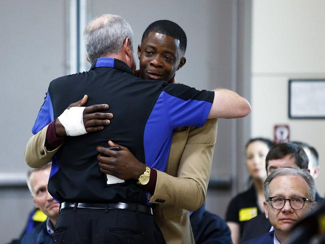 James Shaw, right, gets a hug from Waffle House CEO Walt Ehmer during a press conference on the shooting in Nashville. Shaw wrestled the gun from the suspect. Picture: AP