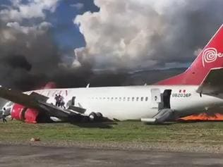 Plane burst into flames on a runway in Peru.