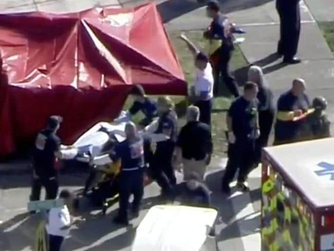 Victims being transported into waiting ambulances. Picture: Telemundo