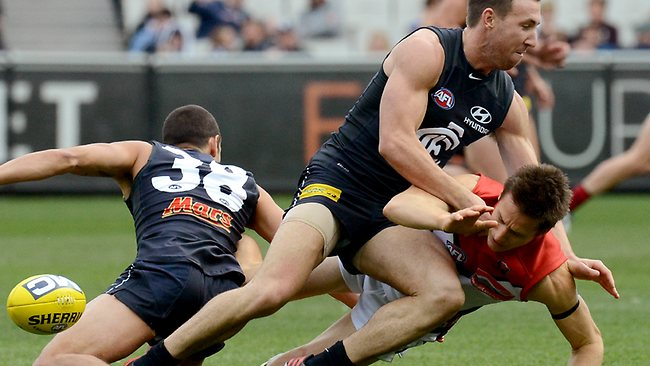 Jack Grimes hurts his shoulder in a tackle from Brock McLean. Picture: Wayne Ludbey