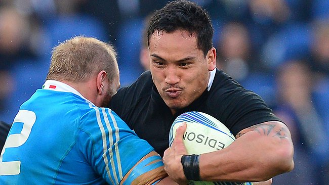 All Blacks winger Hosea Gear is tackled by Italy's hooker Leonardo Ghiraldini at the Olympic Stadium in Rome. Picture; Gabriel Bouys