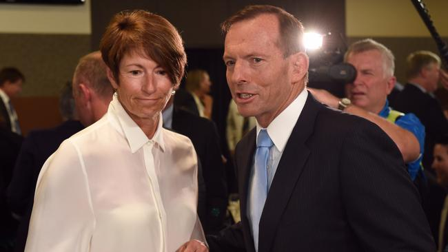 Won't back down ... Prime Minister Tony Abbott and his wife Margie leave the National Press Club in Canberra after his defiant address.