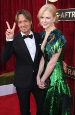 LOS ANGELES, CA - JANUARY 29: Musician Keith Urban (L) and actor Nicole Kidman attend The 23rd Annual Screen Actors Guild Awards at The Shrine Auditorium on January 29, 2017 in Los Angeles, California. 26592_009 (Photo by Dimitrios Kambouris/Getty Images for TNT)
