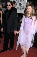 "Calista Flockhart and Robert Downey Jr. The co-stars who played sweethearts on Calista's hit show ""Ally McBeal"" in 2000 took their romance off-screen for awhile. But at the time, Robert was still battling drug addiction and faced two drug possession charges within six months. Needless to say, it was doomed to fail. Now, Robert has been sober for years and married to Nancy Levin while Calista has been with Harrisson Ford since 2002. Picture: Getty Images"