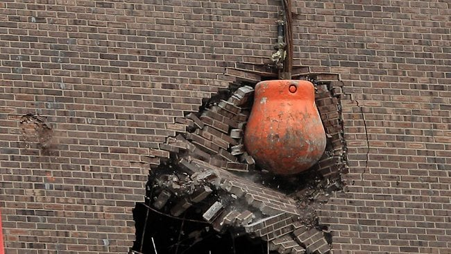 Wrecking Ball Demolition : Woman explodes bomb over lost home