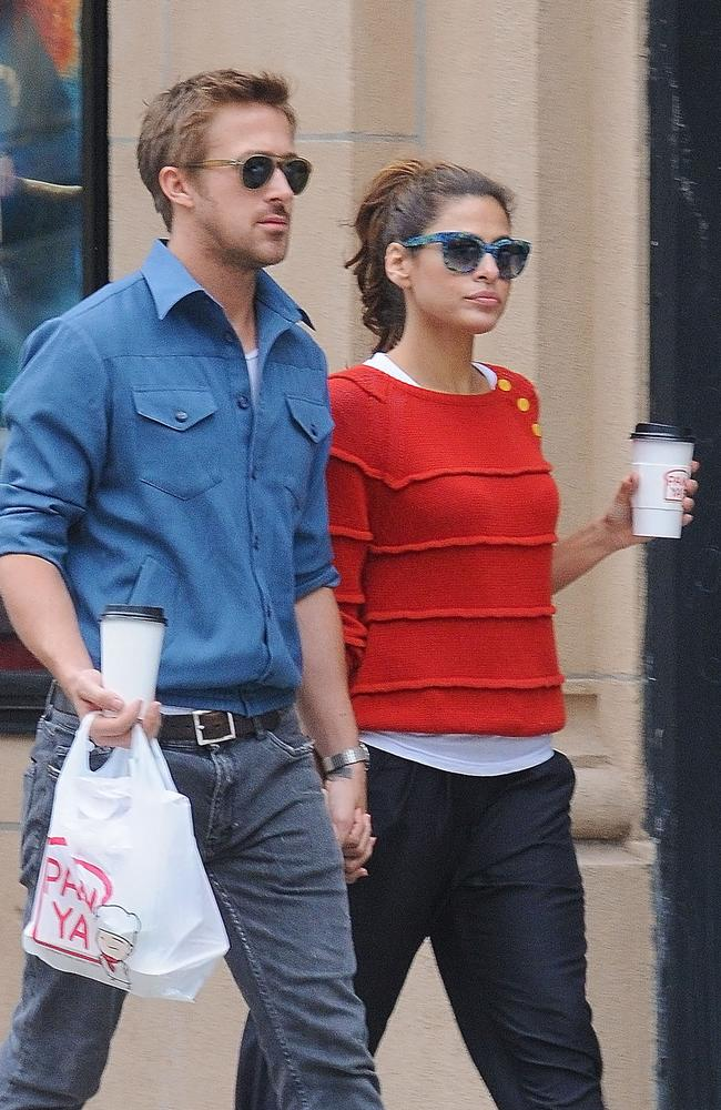 Ryan Gosling and Eva Mendes hold hands on a romantic walk in New York in 2012.