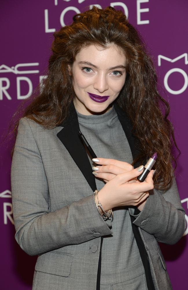 Lorde with the two MAC products she collaborated on.