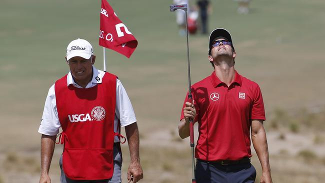 Adam Scott, walks on the fifth green during the third round of the U.S. Open.