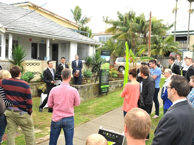Auctioneer Vic Lorusso calling for bids, six parties registered for the old home not far from the beach. Picture: Martin Lange